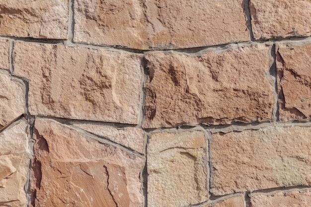 Stenen muur in rode kleur