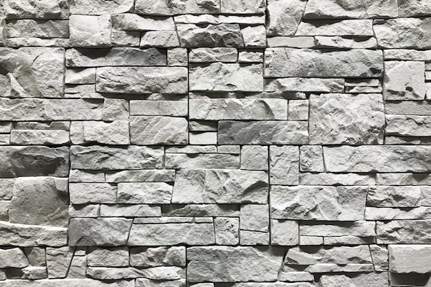 Stenen muur met een grijze achtergrond