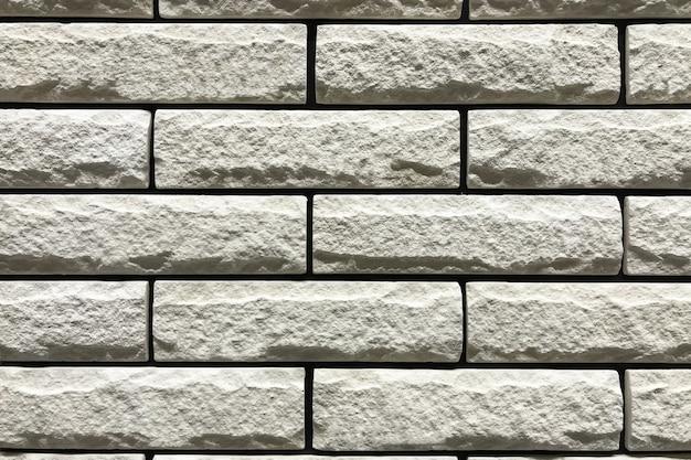 Stenen muur met een grijze kleur. achtergrond en textuur van het concepten de de binnenlandse ontwerp