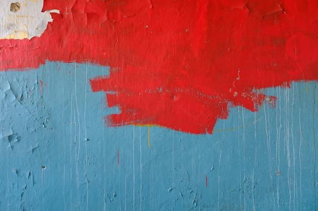 Stenen muur met oude blauwe en rode verf. achtergrondgrunge. hoge kwaliteit foto