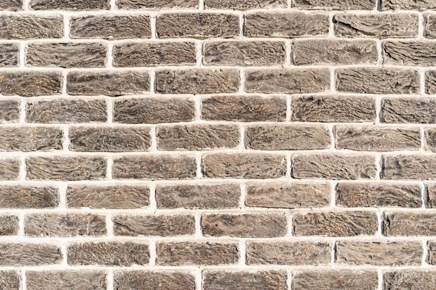 Stenen muur. textuur van grijze roombaksteen met witte vulling