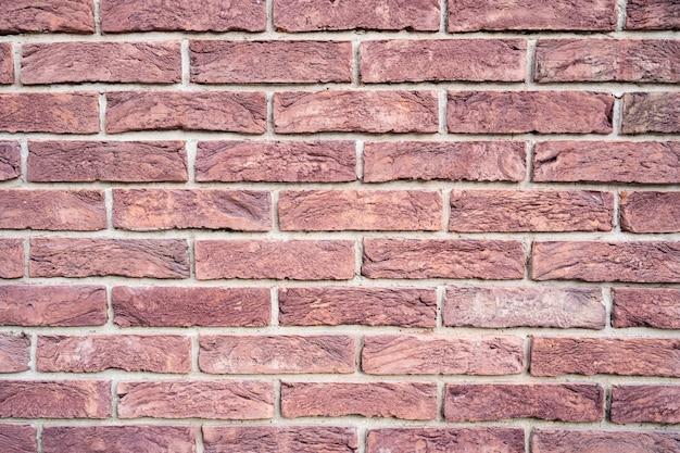 Stenen muur. textuur van rode baksteen met witte vulling