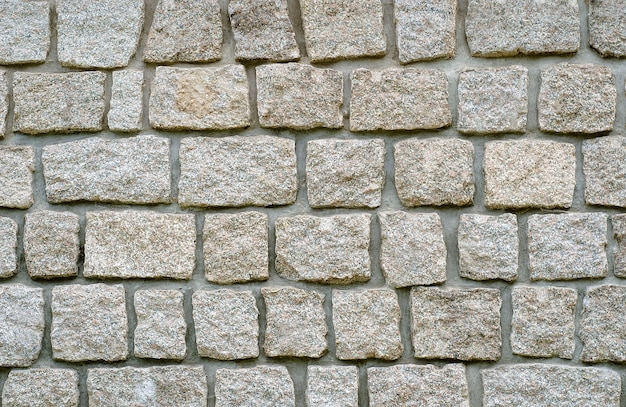 Stenen muur van graniettextuur