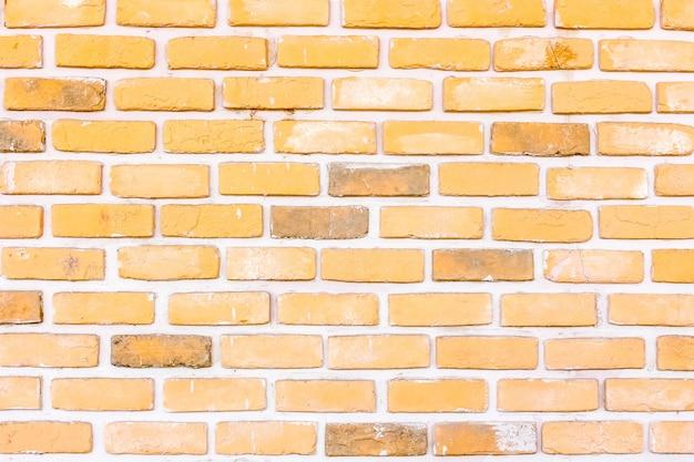 Stenen oranje bakstenen stok in de muur
