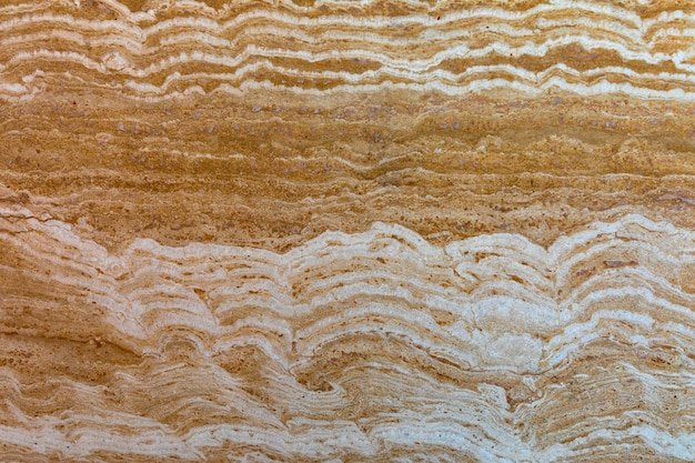 Stenen travertijn tegel, textuur. natuurlijk decoratief materiaal.