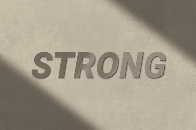 Sterke tekst in een bruin betonnen getextureerd lettertype