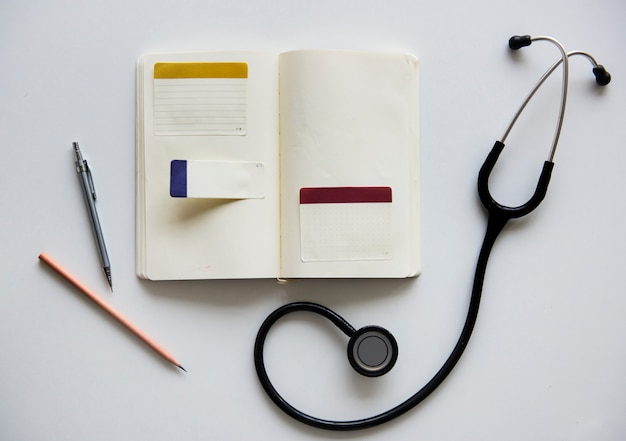 Stethoscoop doctor notebook pen pencil