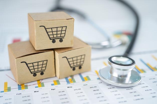 Stethoscoop en winkelwagentje logo op doos met grafiek achtergrond. bankrekening, investeringsanalytische onderzoeksgegevenseconomie, handel, zakelijk import export transport online bedrijfsconcept.