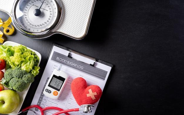 Stethoscoop met patiënten bloedsuiker controlekaart diabetische meetset