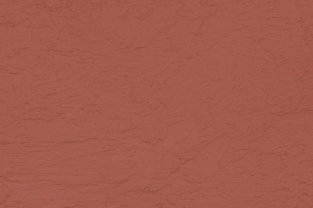 Stevige rode muur getextureerde achtergrond