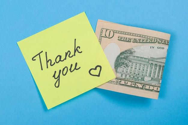 Sticker met woord dank u, en contant geld