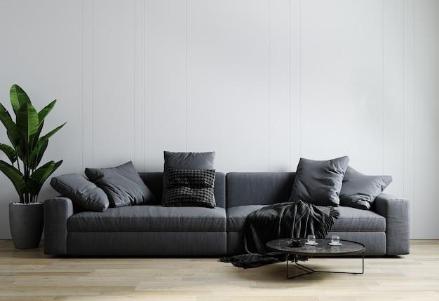 Stijlvol interieur van lichte woonkamer met grijze bank, plant en salontafel met decoratie.