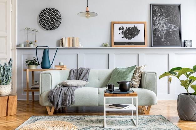 Stijlvol interieur van woonkamer met moderne mint sofa, houten console, kubus, salontafel, lamp, plant, posterframe, kussens, plaid, decoratie en elegante accessoires in home decor.