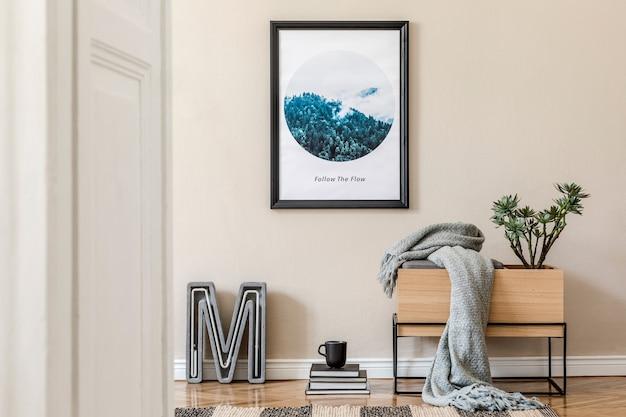 Stijlvolle compositie van creatief zaalinterieur met zwarte mock-up posterframe, houten commode, plaid en accessoires. sjabloon.