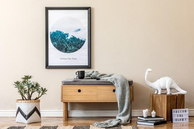 Stijlvolle compositie van gezellig en modern hal/woonkamer interieur met frame, houten commode, plaid, plant en boho accessoires. beige muren, parketvloer.