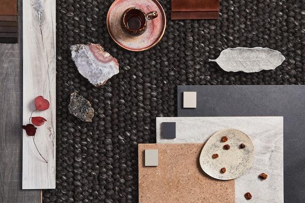 Stijlvolle platliggende compositie van architecten-moodboard met voorbeelden van gebouwen, bruin textiel en natuurlijke materialen en persoonlijke accessoires. bovenaanzicht, sjabloon.