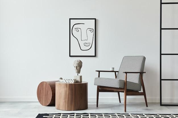 Stijlvolle scandinavische compositie van woonkamer met design fauteuil, zwart posterframe, tapijt decor, houten kruk, decoratie, loft muur en persoonlijke accessoires in modern interieur