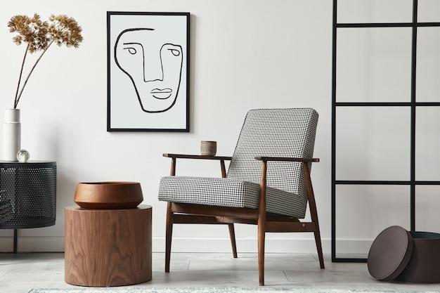 Stijlvolle scandinavische compositie van woonkamer met design fauteuil, zwarte mock-up posterlijst, commode, houten kruk, plant, decoratie, loftmuur en persoonlijke accessoires in modern interieur.