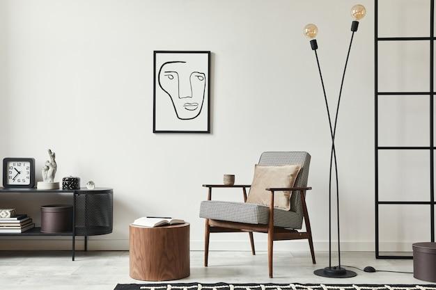 Stijlvolle scandinavische compositie van woonkamer met design fauteuil, zwarte posterlijst, commode, houten kruk, lamp, decoratie, loftmuur en persoonlijke accessoires in modern interieur.