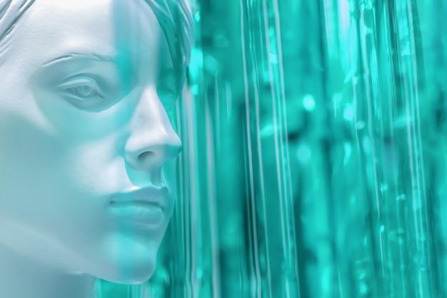 Stijlvolle schoonheid mannequin vrouwelijk hoofd op wazig fel gekleurde koud groen