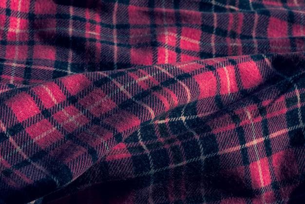 Stof met een kleurrijk ruitjespatroon. roze geruite stof. stoffen checkbox-ontwerpcombinatie van roze witgrijze kleur.