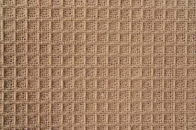 Stof natuurlijke textuur als achtergrond. beige natuurlijke katoenen wafel stof textuur als achtergrond