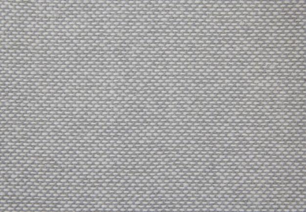 Stof textuur close-up. grijze stof. natuurlijke stof. grijze achtergrond.