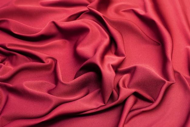Stof textuur, close-up van rode stof achtergrond.