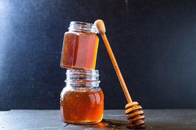 Stok op honingpotten