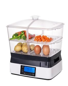 Stoomboot voor groenten en gezonde voeding. vegetarisme. dubbele ketel in wit