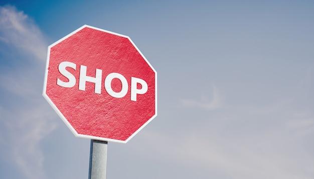 Stop-bord met het woord shop-concept van zaken en winkels