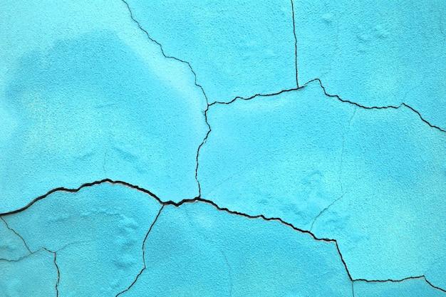 Straat muur achtergrond, textuur van het betonnen oppervlak van het blauw Premium Foto