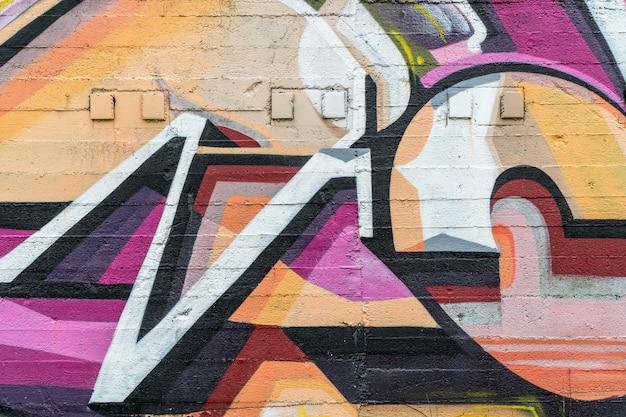 Straatkunst, kleurrijke graffiti op de muur