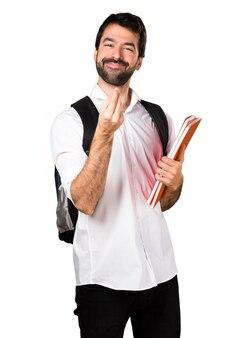 Student man maken geld gebaar