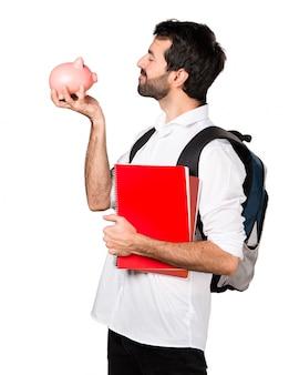 Student man met een piggybank
