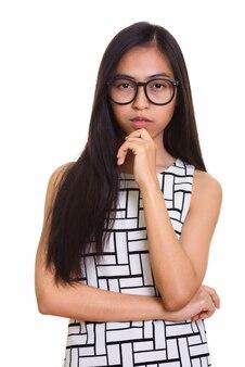 Studio die van het jonge aziatische tienernerdmeisje denken is ontsproten