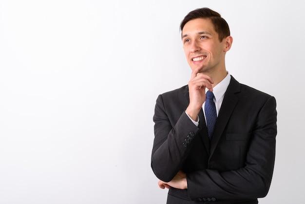 Studio die van jonge gelukkige en zakenman die whil glimlachen is ontsproten is ontsproten