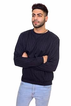 Studio shot van jonge gelukkig indiase man geïsoleerd tegen een witte achtergrond