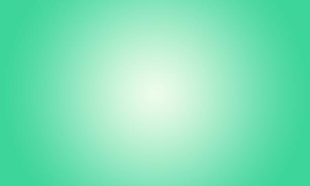 Studioachtergrond - de heldergroene achtergrond van de de ruimtemuur van de gradiëntmuur.