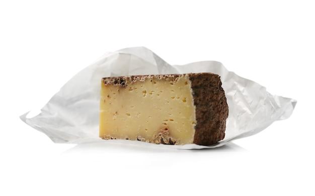 Stuk kaas op een witte ondergrond