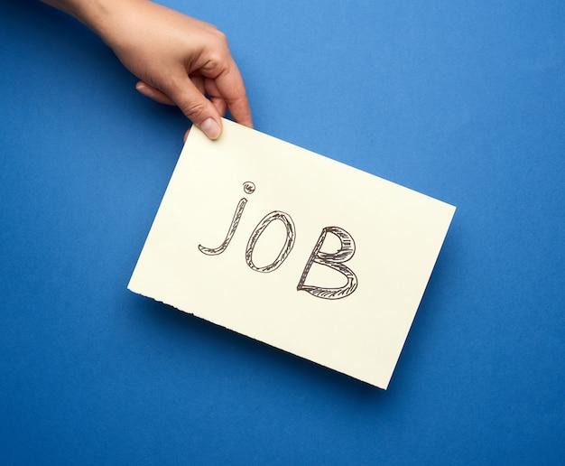 Stuk papier met de inscriptie baan, concept van werkloosheid