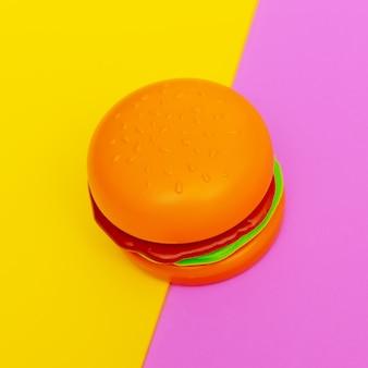 Stuk speelgoed hamburger op gekleurde achtergrond. fastfood plat lag concept art