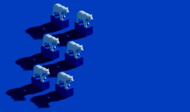 Stuk speelgoed ijsberen en blauwe blokken op oceaanblauwe achtergrond. patroon met harde schaduwen en exemplaarruimte. red het arctische en broeikaseffect-concept