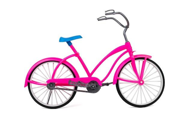Stuk speelgoed lopende fiets geïsoleerd. milieuvriendelijk vervoermiddel.