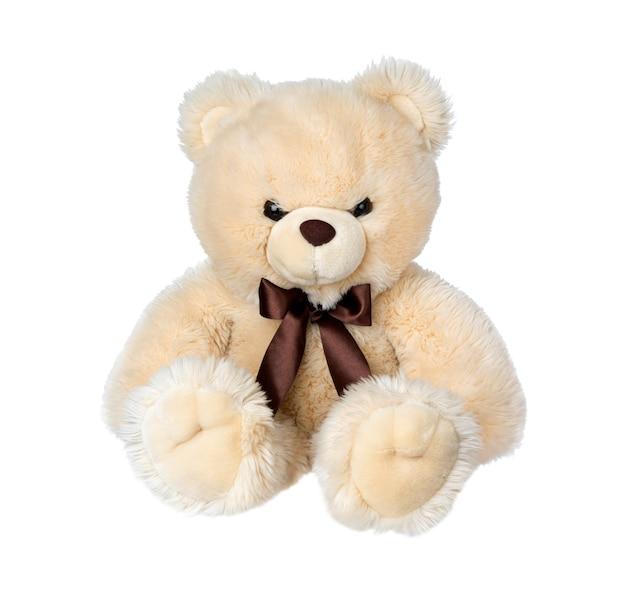 Stuk speelgoed teddybeer die op wit oppervlak wordt geïsoleerd