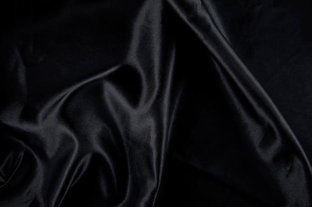 Stuk zwart satijn textuur