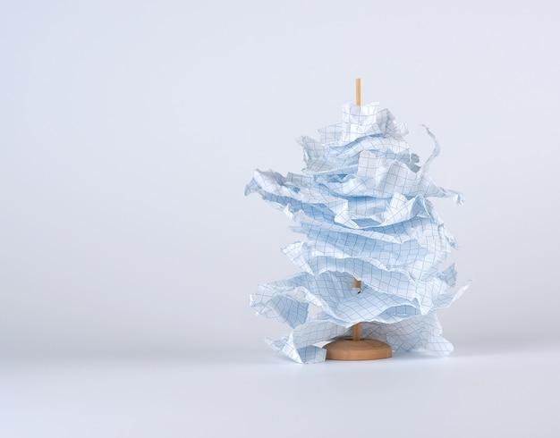 Stukjes gescheurd wit papier worden op een houten stok geregen
