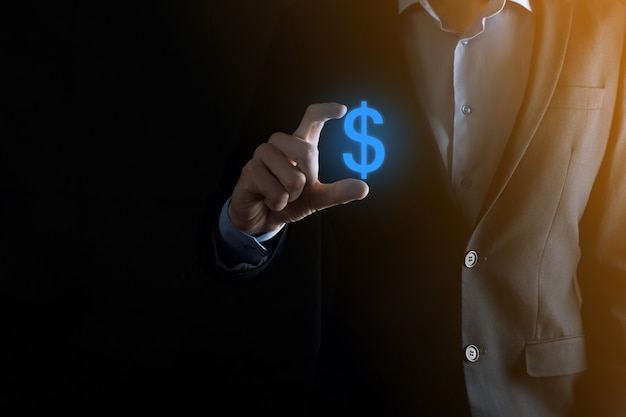 Succesvol internationaal financieel symbool sinvestment concept met zakenman man persoon greep die groei, grafieken en dollarteken, digitale technologie toont.