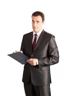 Succesvolle zakenman die in klembord schrijft