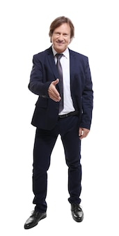 Succesvolle zakenman die zijn hand uitstrekt om te schudden,
